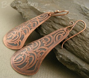 Etched copper earrings, cut into a fan shape and given a slight curl.