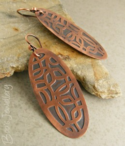 Etched copper earrings with a deep patina and satin surface finish.