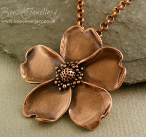 Wild rose pendant in antiqued copper.