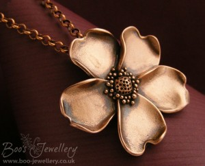 Wild rose pendant made in copper metal clay.