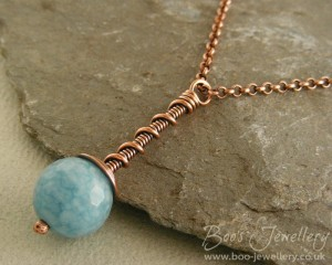 'Coil on coil' pendant featuring a lovely delicate aquamarine jade bead with a lovely marbled texture.