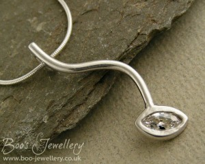 Contemporary silver pendant set with a large marquise Cubic Zirconia faceted gemstone.
