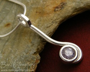 Large lavender coloured Cubic Zirconia wrapped in a swirl of solid silver.