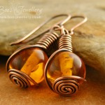 Faux amber rosebud knot wrapped earrings in antiqued copper.