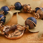 Lapis Lazuli antiqued copper spiral wrapped toggle bracelet. The toggle texture is from my own texture plate from a digital drawing.