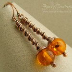 Antiqued copper coil on coil earrings featuring more of the gorgeous faux amber beads I mentioned in my last post.