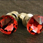 Swarovski Elements crystals (Padparadscha colour) and surgical steel post earrings.