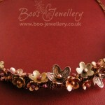 Flower garland necklace featuring copper and bronze flowers, molten buds and twisted ropes.