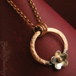 A new version of my flower ring pendant with a pure silver flower, ball riveted with a bronze ball.