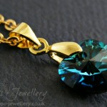 Gorgeous 'Bermuda' coloured Swarovski heart pendant with gold plated metalwork.