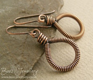 Coiled copper teardrop loop earrings.
