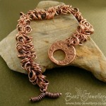 Antiqued copper double shaggy loops bracelet with a hand crafted toggle clasp.