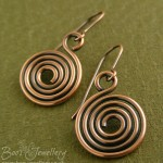 Un-hammered spiral earrings in antiqued copper.