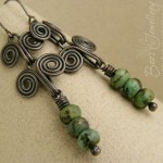 Darkly oxed Egyptian coil earrings with an African turquoise rondelle stacked dangle.