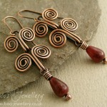 Antiqued copper Egyptian coil earrings with a pretty little Tourmaline teardrop.