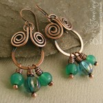 Whilst I was in a coiling mood I made these chandalier stype earrings with turquoise glass beads and hammered spirals.
