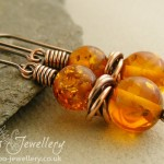 Faux amber and mobius ring antiqued copper earrings.