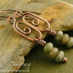 Elongated spiral link antiqued copper earrings with a stack of peace jade rondelles.
