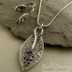 Pure silver pendant, set with an amethyst coloured marquise shaped cubic zirconia gemstone.