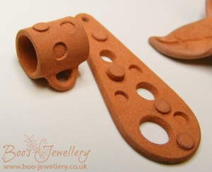 The dry super flex clay was cut on the Silhouette for these two pieces and the tube bail was rolled (very gently) from dry, cut clay.
