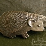 Brooch pin of my son's African Pygmy Hedgehog Bruce. I hope that I've managed to capture his individual look (he has especially long forehead quills and larger, square ears) and cheeky personality.