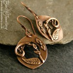 Pink bronze earrings featuring tiny hand crafted tendrils and leaves.