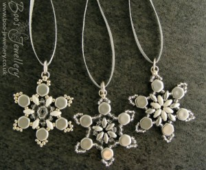 Beaded snowflake decorations, which can be removed from the ribbon and worn as a pendant,