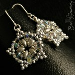 Beaded star earrings in icy colours and hanging on Sterling silver earwires.