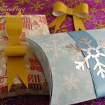 Pillow boxes cut from card printed with digital paper designs.