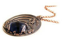 Copper midnight scene pendant with vintage glass cabochon, available from Boo's Jewellery.