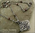 Silver and garnet necklace with square pendant