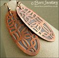 Oval shaped etched copper earrings with retro geometric design