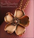 Solid copper hand sculpted wild rose pendant