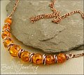 Faux amber and copper necklace with mobius ring separators