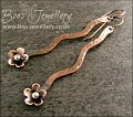 Antiqued copper squiggle drop and flower earrings