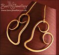 Polished hammered bronze curly heart earrings