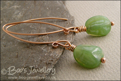 Polished bronze and green glass nugget earrings