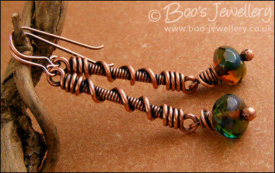 Coil on coil long drop earrings with glass dangles