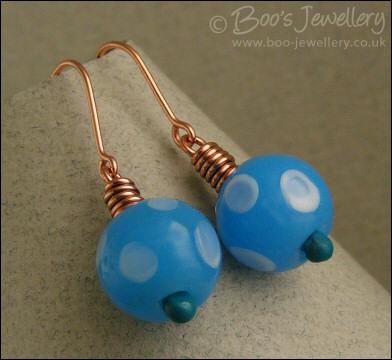 Blue spotty glass and polished copper earrings