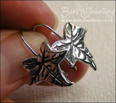 Solid silver one piece ivy leaf drop earrings with cubic zirconium