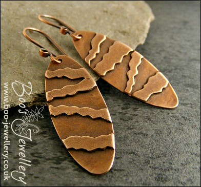 Long oval earrings with geometric stripe decoration