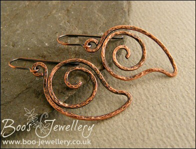 Loosely spiralled leaf shaped hammered copper earrings