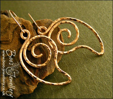 Open leaf spiral hammered and polished bronze earrings