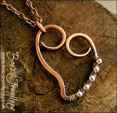 Small antiqued copper curly heart pendant wrapped with silver beads