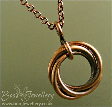 Antiqued copper mobius flower pendant on belcher chain