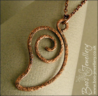 Open leaf spiral shaped hammered texture copper pendant