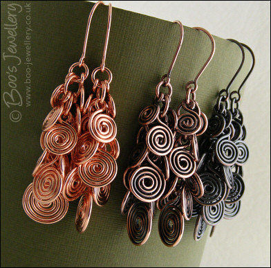 Fluid copper spirals earrings