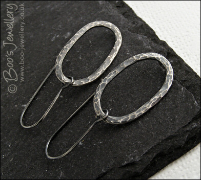 Sterling silver earrings with oxidised and textured oval loops