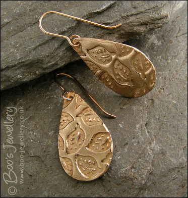 Bronze teardrop earrings with hand drawn leaf imprint